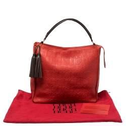Carolina Herrera Red Monogram Embossed Leather Tassel Hobo