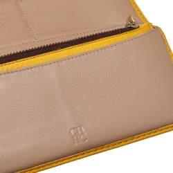 محفظة كونتيننتال كارولينا هيريرا جلد أصفر مونوغرامي