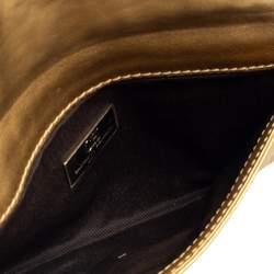 حقيبة كلتش كارولينا هريرا بشراشيب جلد مونوغرامي ذهبي ميتالك