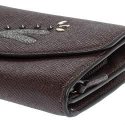 محفظة كونتيننتال كوتش جلد عنابي بقلاب