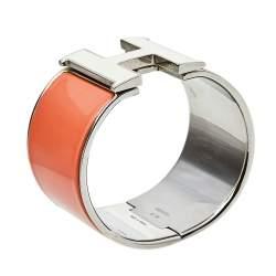 سوار هيرمس كليك كلاك إتش إيناميل برتقالي مطلي بلاديوم عريض جدًا مقاس صغير