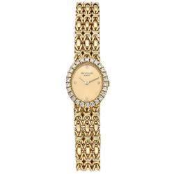 Patek Philippe Champagne Diamonds 18K Yellow Gold Vintage Oval 4752/001 Women's Wristwatch 18 MM