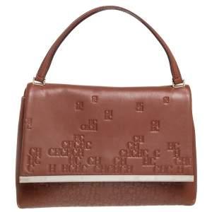 حقيبة كارولينا هيريرا جلد بني منقوش بيد علوية