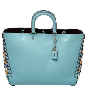 حقيبة كوتش جلد أزرق مزينة