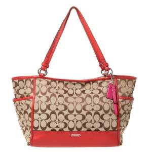 Coach Beige/Orange Signature Canvas and Leather Carrie Tote
