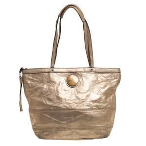 حقيبة يد كوتش جلد ذهبي ميتاليك