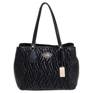 حقيبة كوتش كيت كاري أول جلد أسود بطيات