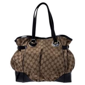 حقيبة يد غوتشي Full Moon متوسطة جلد لامعة وكانفاس GG سوداء/ بيج