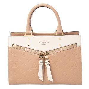 حقيبة يد لوي فيتون سولي جلد إمبرينت مونوغرامي كريمية PM