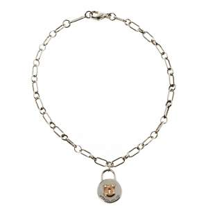 Tiffany & Co. Silver 18K Rose Gold Round Lock Charm Bracelet