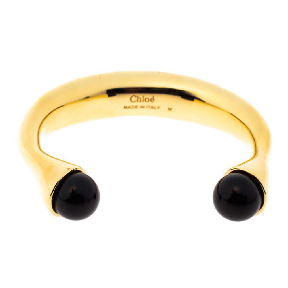 سوار كلوي أسورة مفتوحة ذهبية اللون مزين بخرز أسود مقاس وسط (ميديوم)