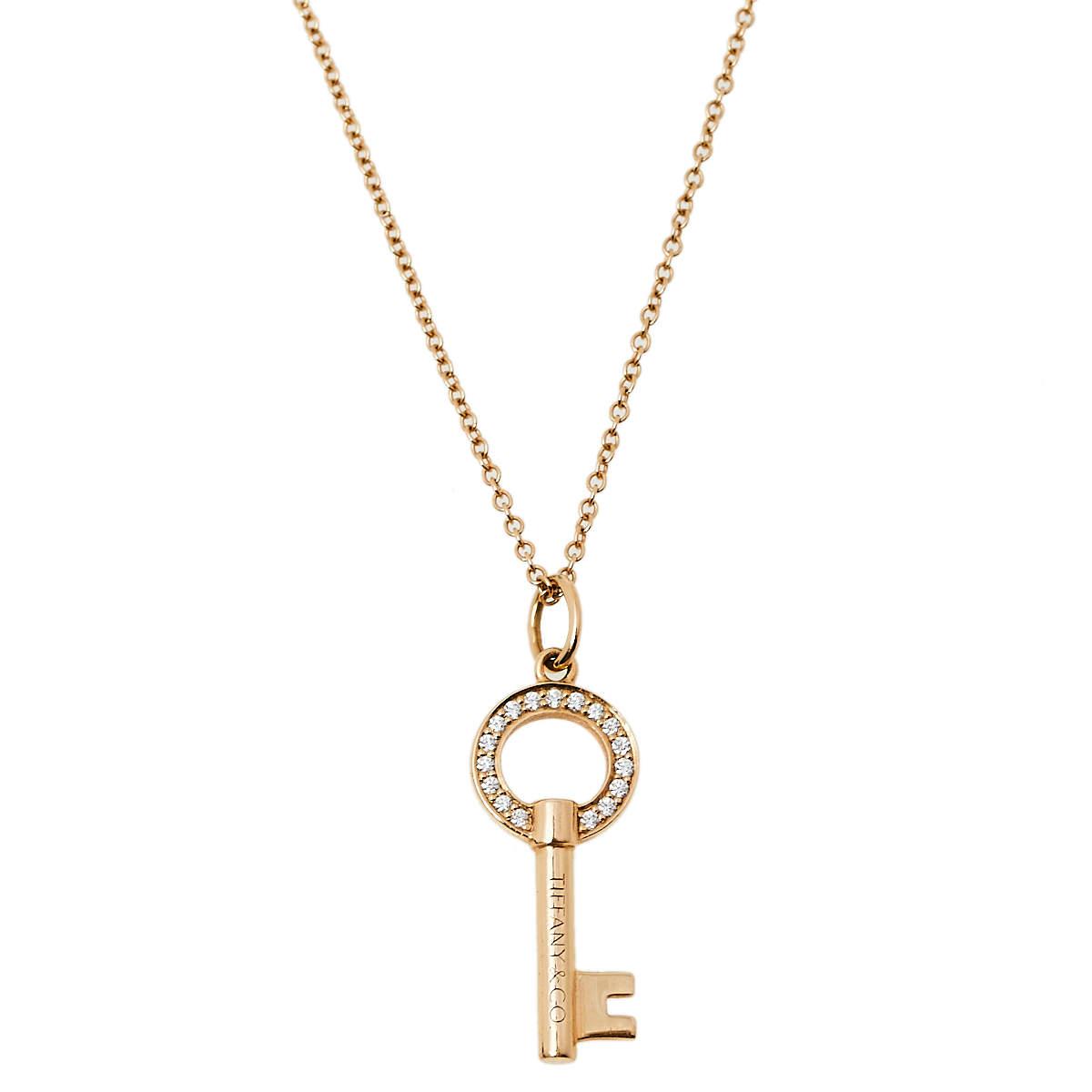 Tiffany & Co. Tiffany Keys Modern Open Round Keys Diamond 18k Gold Pendant Necklace