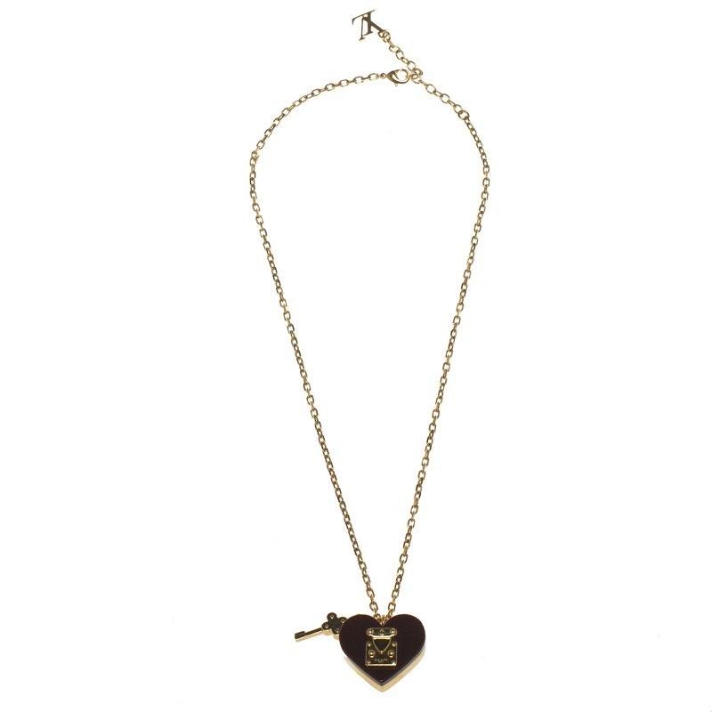 fbb4a0c8c6af Louis Vuitton Lock Me Burdy Gold Tone Pendant Necklace. Louis Vuitton  Lockme Ii Handbag ...