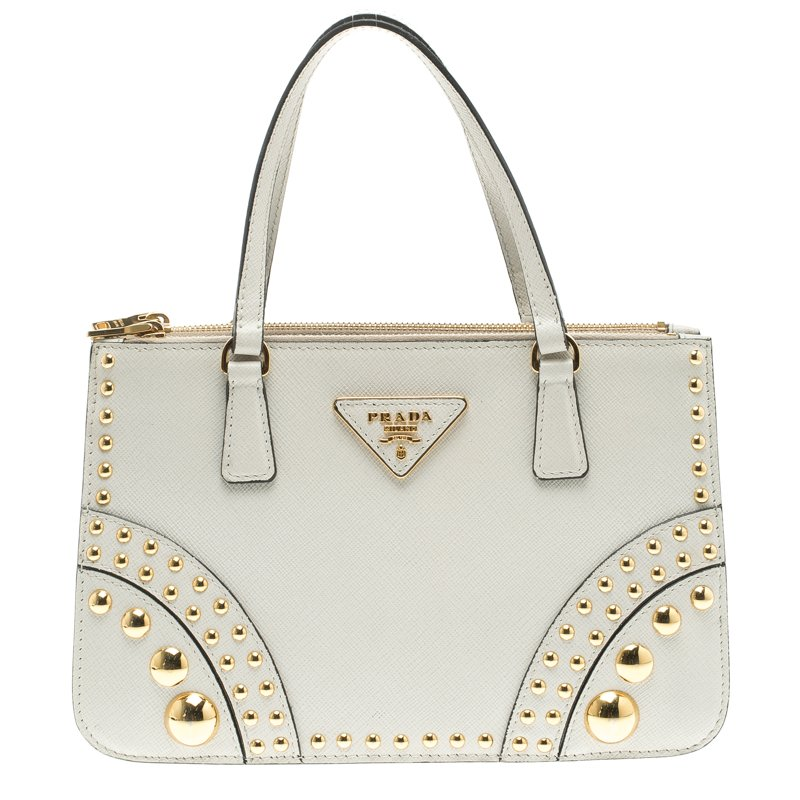 5980ffe40f8e ... Prada Off White Saffiano Leather Studded Double Zip Tote. nextprev.  prevnext