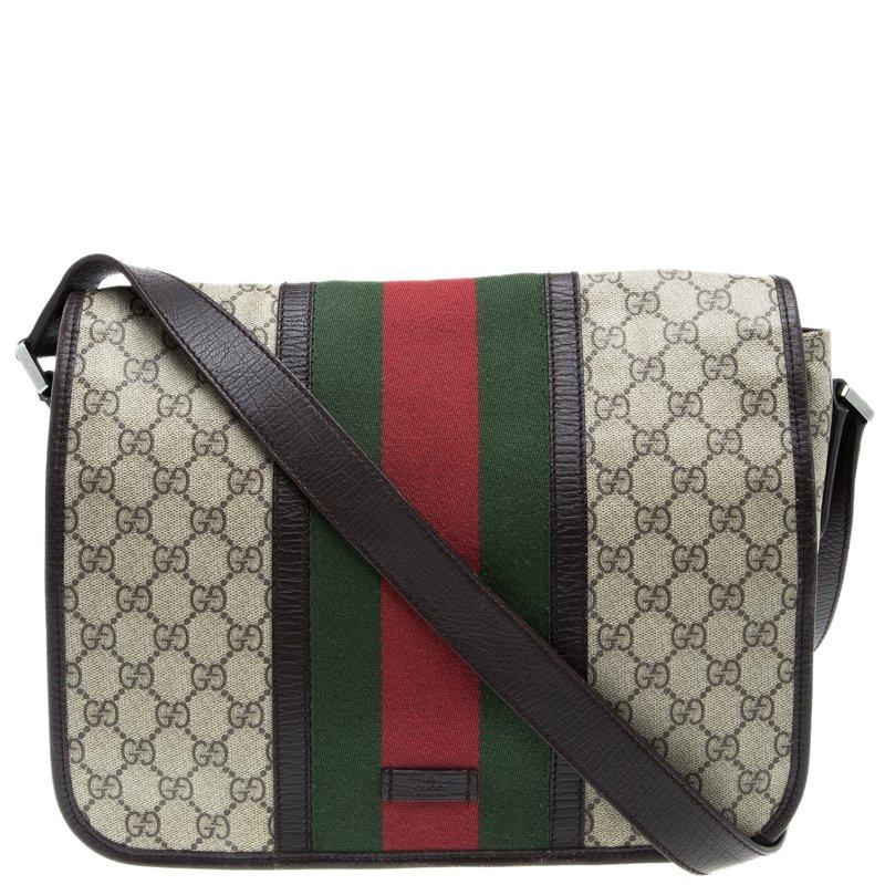 0e46e0e174be ... Gucci Beige/Brown GG Supreme Canvas Web Messenger Bag. nextprev.  prevnext