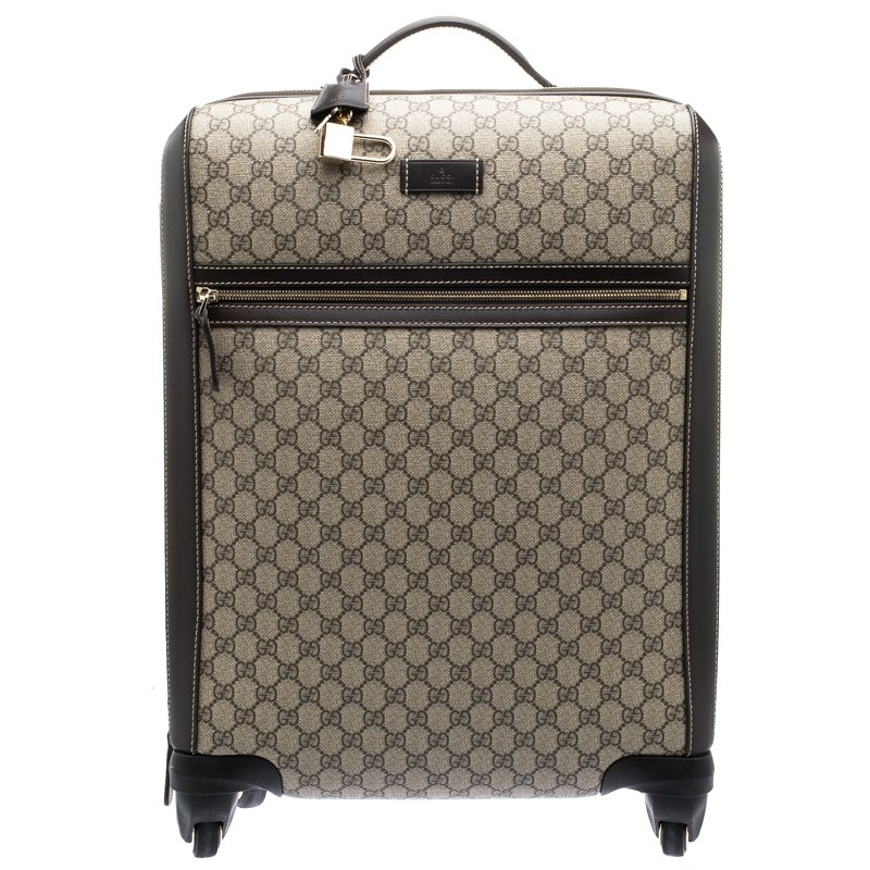 75a19d303e32 ... Gucci Beige/Ebony GG Supreme Canvas Medium Four Wheel Carry-On Suitcase.  nextprev. prevnext