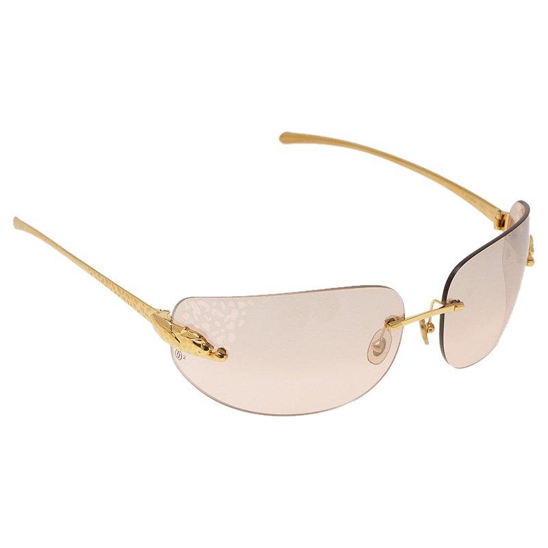 19aa0eada7b ... Cartier Gold Panthere De Cartier Shield Sunglasses. nextprev. prevnext