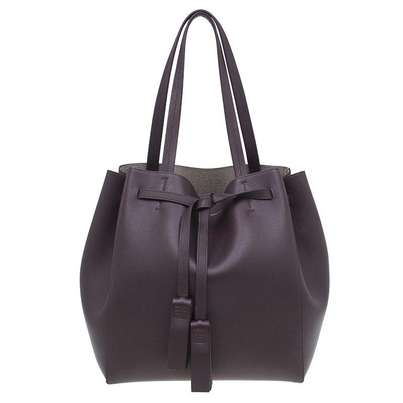 54ac302ed1 ... Celine Burgundy Leather Medium Tassel Phantom Cabas Tote. nextprev.  prevnext