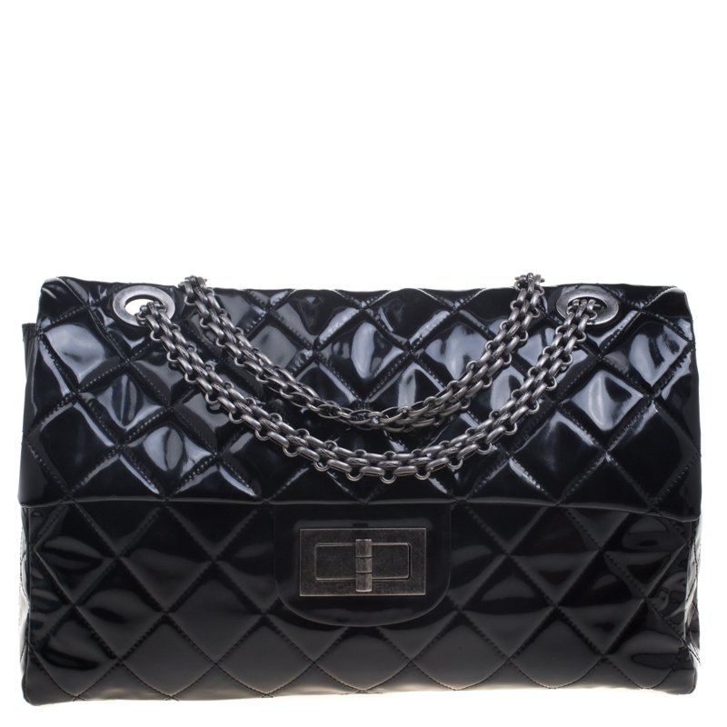 e7382463899c4a ... Chanel Black Quilted Patent Leather XXL Reissue Travel Bag. nextprev.  prevnext