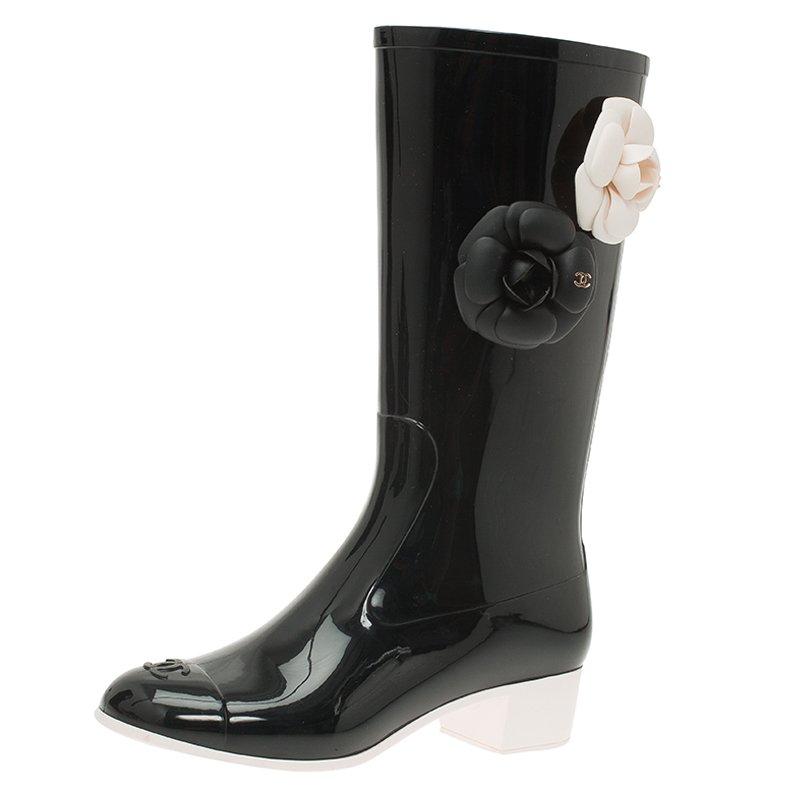 890894701 ... Chanel Black Camellia Rubber Rain Boots Size 36. nextprev. prevnext