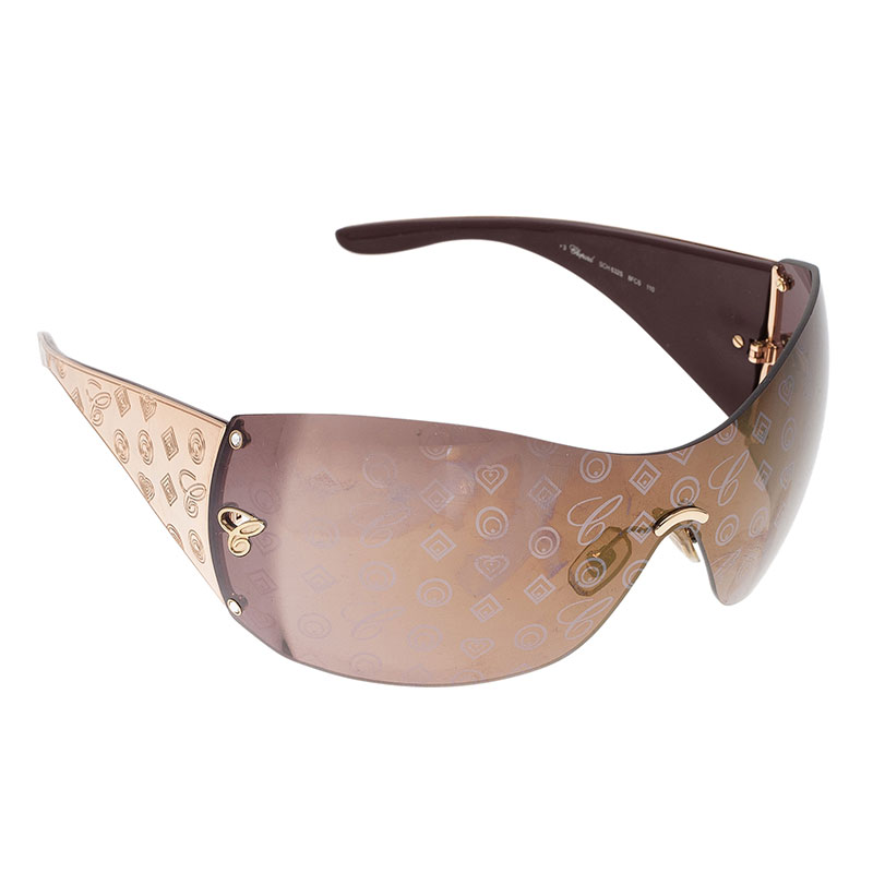 be1a2aaa1ab4 ... Chopard Gold Monogram SCH632 Shield Sunglasses. nextprev. prevnext