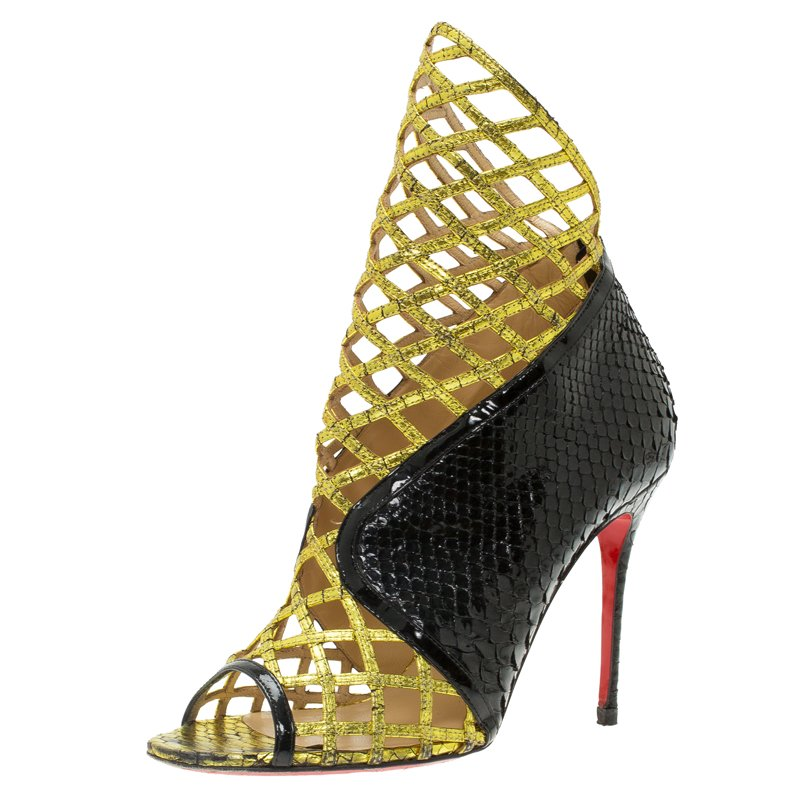 huge selection of 4426d 41e6b Christian Louboutin Black and Gold Python Bougliona Cage Ankle Boots Size  38.5