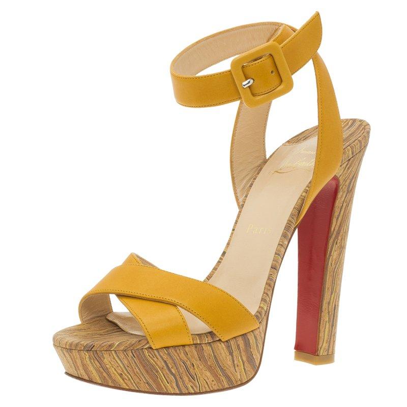 1b4fecf1e0 Buy Christian Louboutin Yellow Leather Criss Cross Ankle Strap ...