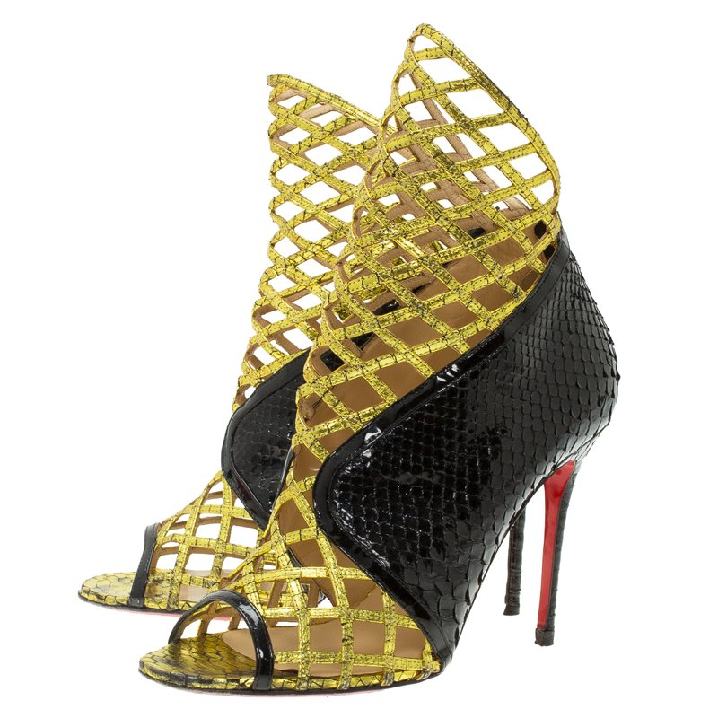 huge selection of baaa2 f1417 Christian Louboutin Black and Gold Python Bougliona Cage Ankle Boots Size  38.5