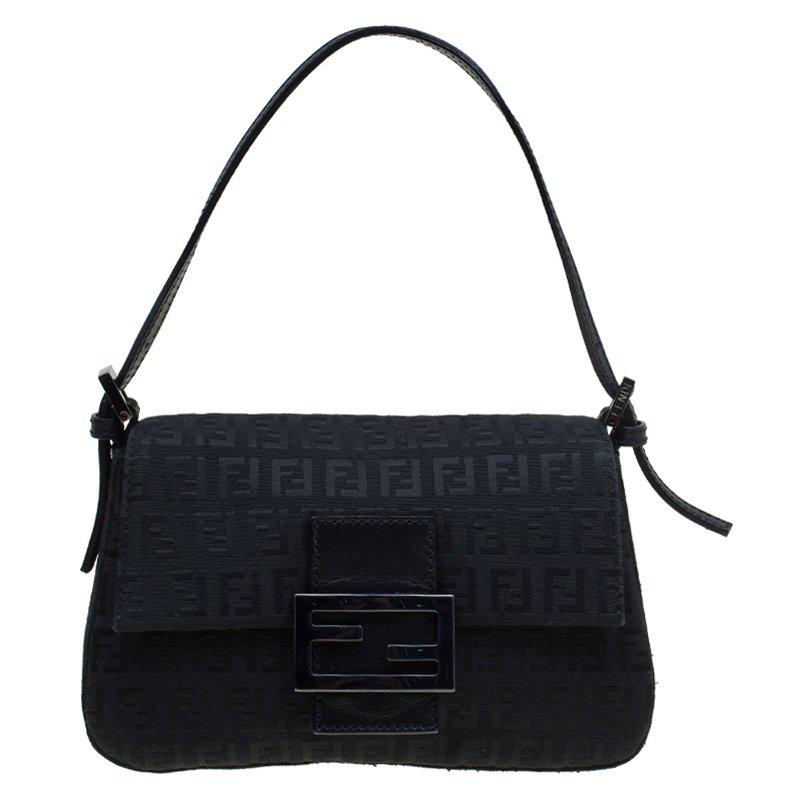09332989472c ... Fendi Black Zucchino Canvas Mini Mama Baguette Bag. nextprev. prevnext