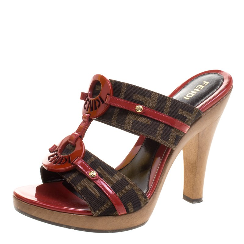 6b01ef2b9c2e ... Fendi Tobacco Red Zucca Canvas and Leather Logo Mules Sandals Size 37.  nextprev. prevnext