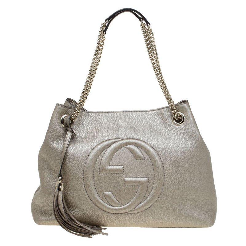 bf31195fe ... Gucci Metallic Beige Pebbled Leather Medium Soho Tote. nextprev.  prevnext