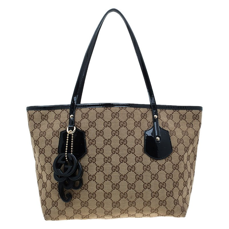 50e53483f84d ... Gucci Beige GG Canvas Medium Jolie Charm Tote Bag. nextprev. prevnext