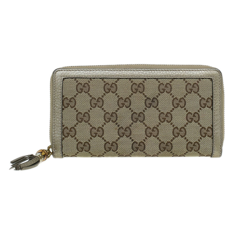 7d7e869bcc7512 Buy Gucci Beige GG Canvas and Leather Tassel Zip-around Continental ...