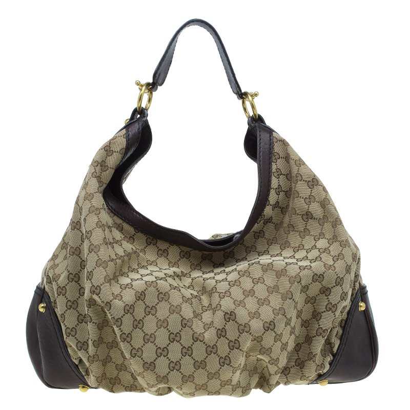 7000db90964 ... Gucci Beige Brown GG Canvas and Leather Large Jockey Hobo. nextprev.  prevnext