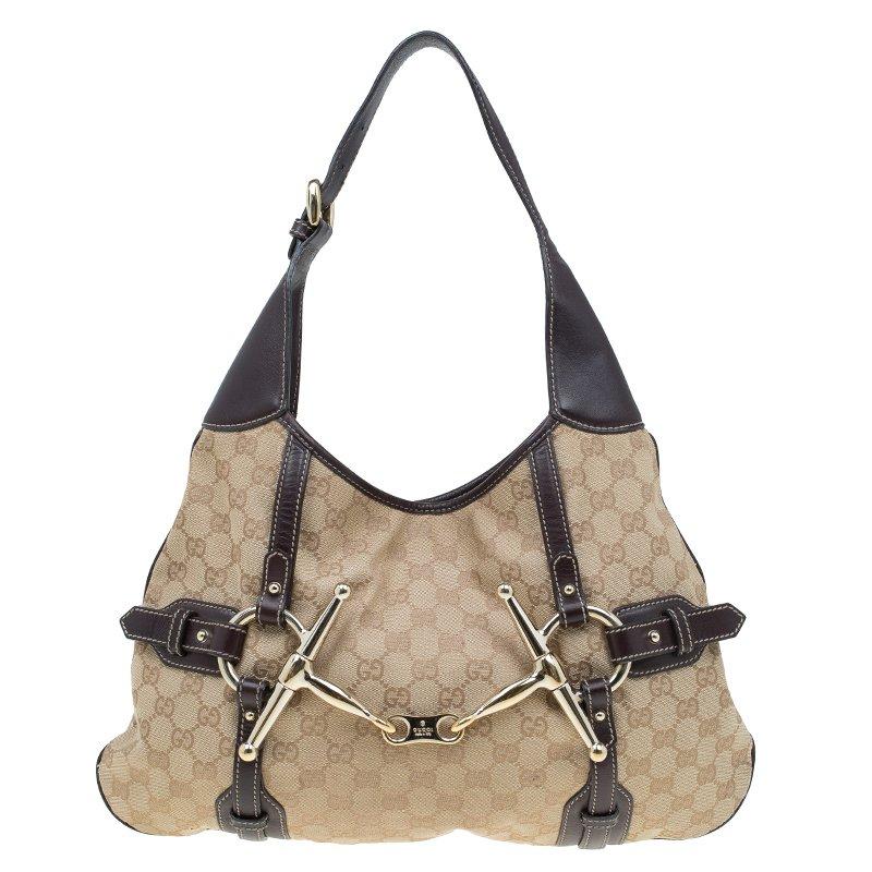 10ec59c34fe Buy Gucci Beige Ebony GG Canvas 85th Anniversary Bridle Bit Hobo ...