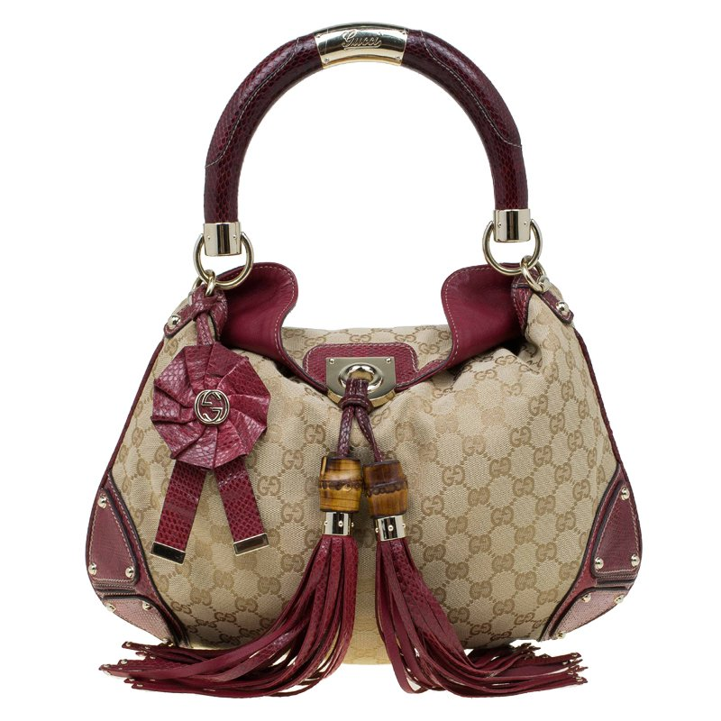ad9d8ef548c ... Gucci Beige Red GG Canvas and Python Medium Indy Top Handle Bag.  nextprev. prevnext