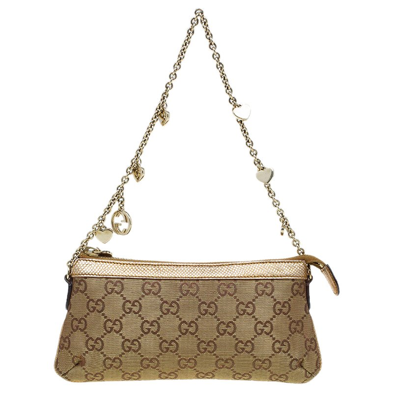 1d82bd6a097 ... Gucci Gold GG Canvas and Snake Embossed Leather Chain Pochette.  nextprev. prevnext