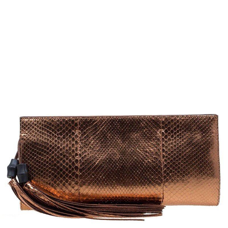 f2d57e72ba8a Buy Gucci Bronze Python Large Tassel Clutch 74187 at best price | TLC
