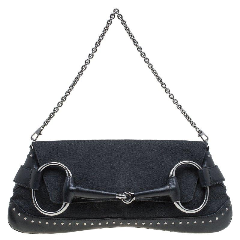 ... Gucci Black GG Canvas Studded Horsebit Chain Clutch. nextprev. prevnext c0587a2774d91