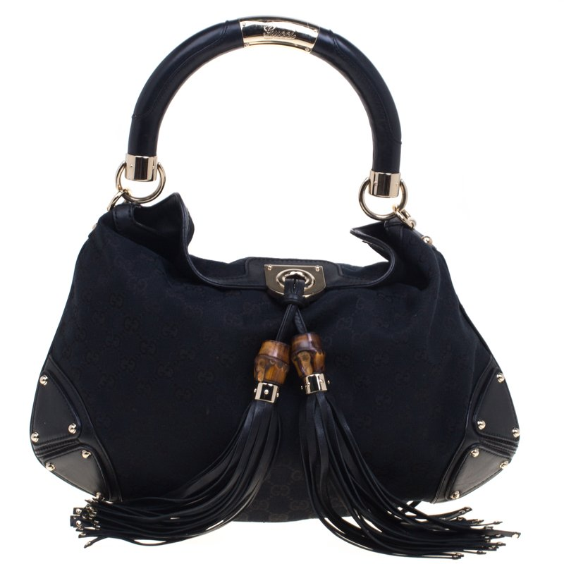 a12a6ddb2f0 Gucci Black Gg Canvas Medium Babouska Indy Top Handle Bag 92664. Gucci  Monogram Medium Indy Hobo Ivory