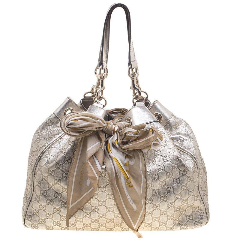 5fe2594e850 ... Gucci Gold Guccissima Leather Positano Scarf Tote. nextprev. prevnext