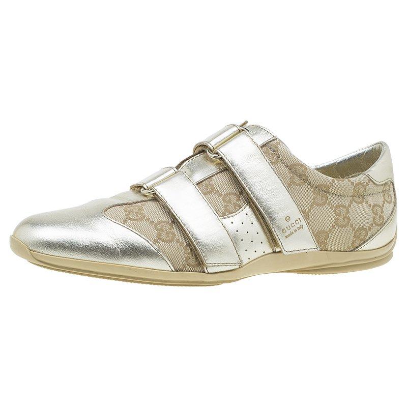 63b502cc2 ... Gucci Metallic Gold Guccissima Canvas and Leather Velcro Sneakers Size  38. nextprev. prevnext