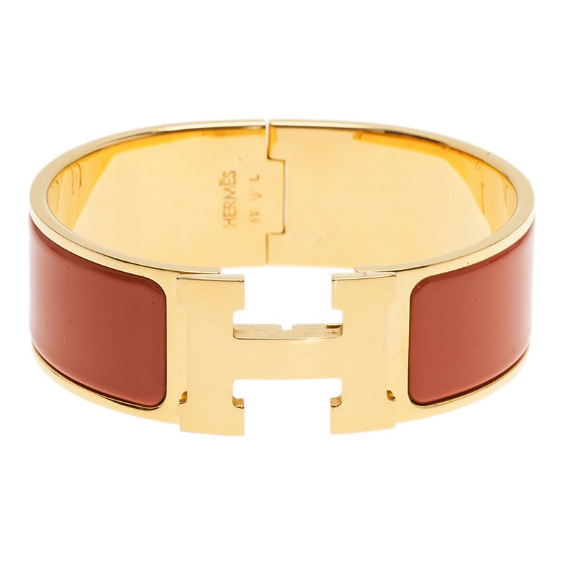 1118fd1f6744cd ... Hermes Clic Clac H Wide Gold-Plated Orange Enamel Bracelet PM.  nextprev. prevnext