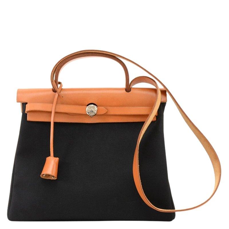 2f77f8628bc7 ... Hermes Bi Color Canvas Leather 2-in-1 Herbag PM Bag. nextprev. prevnext