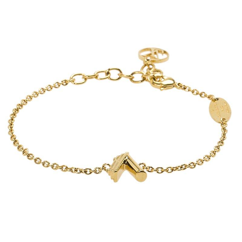 c551a1181372 ... Louis Vuitton LV   Me Letter V Gold Tone Bracelet. nextprev. prevnext