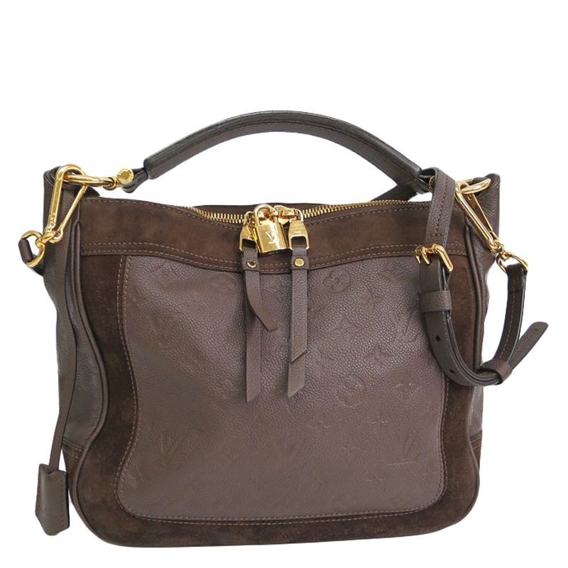 6d362176dd90 ... Louis Vuitton Terre Monogram Empreinte Leather Audacieuse PM Bag.  nextprev. prevnext