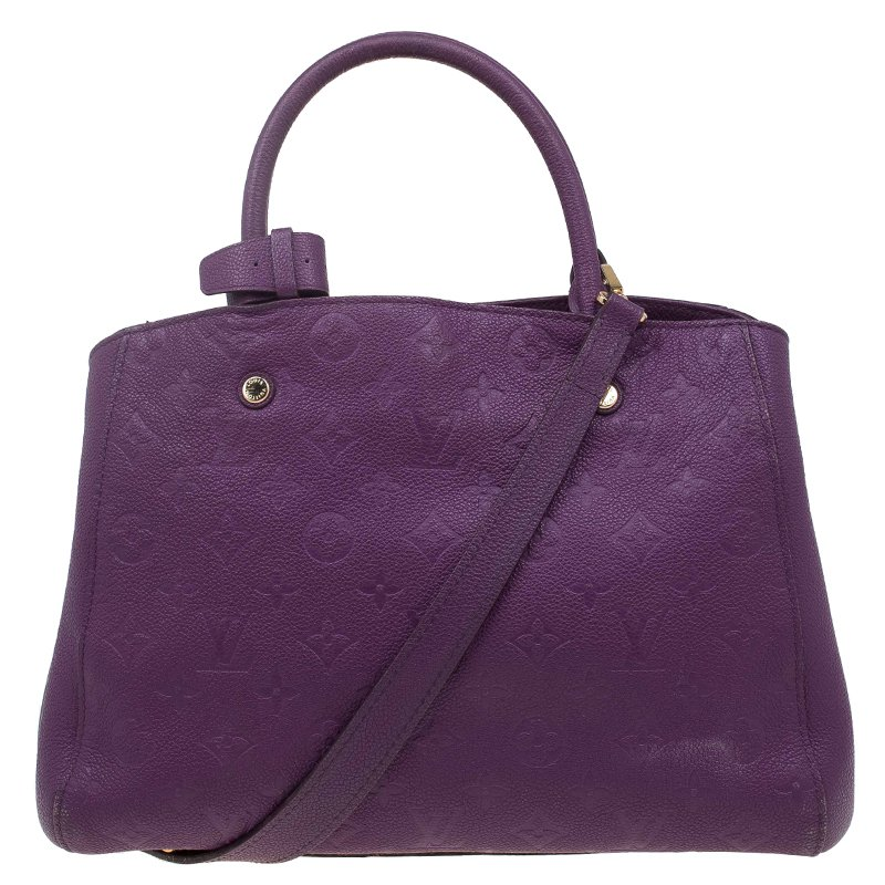 5074abfcd75a ... Louis Vuitton Amethyste Monogram Empreinte Montaigne MM Bag. nextprev.  prevnext