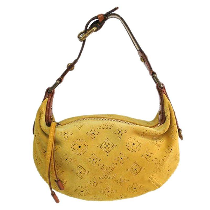 35789f331560 ... Louis Vuitton Yellow Monogram Suede Limited Edition Onatah PM Bag.  nextprev. prevnext