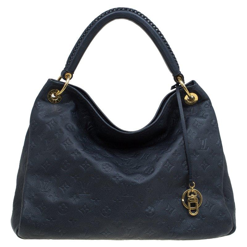 558a1c0a8a34 ... Louis Vuitton Black Monogram Empreinte Leather Artsy MM Bag. nextprev.  prevnext