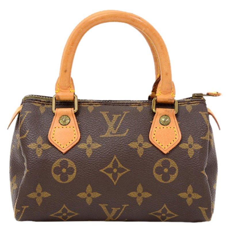 ... Louis Vuitton Monogram Canvas Mini Speedy HL Bag. nextprev. prevnext 3fa75a1676380